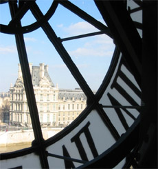 View on the Louvre Museum from the inside of the Orsay Museum - Through the large clock - top floor
